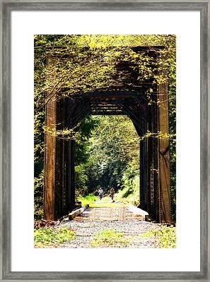 Bicycling Across Old Train Bridge Framed Print