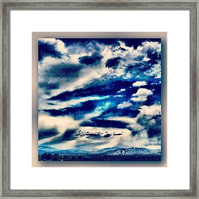 Big Clouds Tiny Mountains Framed Print