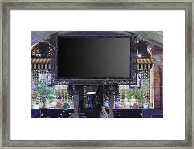 Big Screen In Restaurant Framed Print by Magomed Magomedagaev