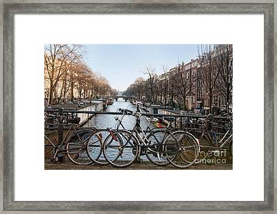 Bikes On The Canal In Amsterdam Framed Print by Carol Ailles