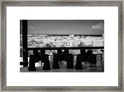 binoculars at observation point for tourists overlooking the UN buffer zone in cyprus Framed Print by Joe Fox