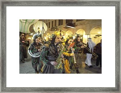 Bizarre Street Band In Doha Framed Print by Paul Cowan