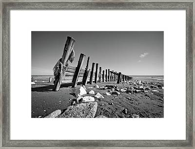 Black And White Beach With Rocks And Wood Framed Print by Billy Richards Photography