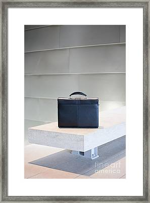 Black Briefcase On White Stone Bench Framed Print by Jetta Productions, Inc