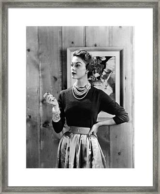 Black Cashmere Pullover Is Worn Framed Print by Everett