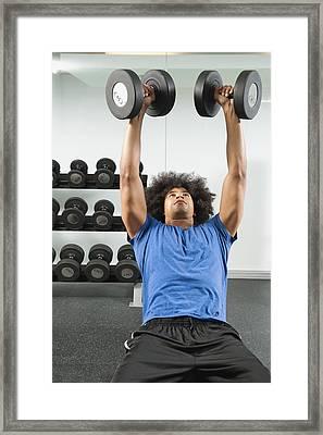 Black Man Lifting Dumbbells In Gym Framed Print by Erik Isakson