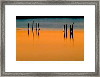 Black Pilings Orange Water Framed Print