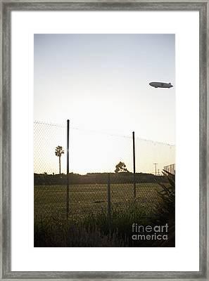 Blimp Flying Over Sports Field Framed Print by Sam Bloomberg-rissman