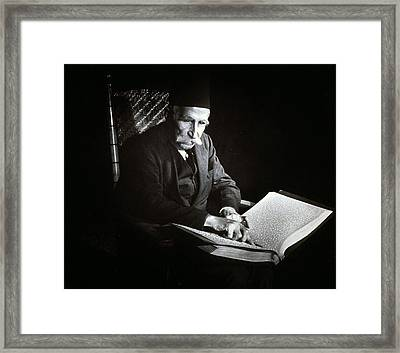 Blind Man Reading A Braille Book, Ca Framed Print by Everett