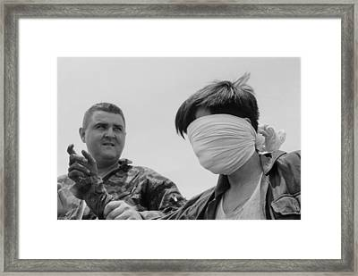 Blindfolded Viet Cong Pow. Us Marine Framed Print by Everett