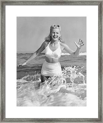 Blonde Woman In Two Piece Bathing Suit Framed Print by George Marks
