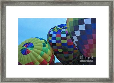 Blowing Up The Balloons Framed Print by Ginger Harris