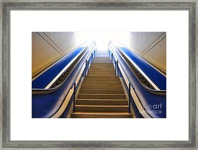Blue Escalators Framed Print