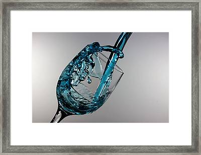 Blue Martini Splashing From A Wine Glass Framed Print by Paul Ge