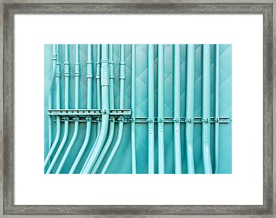 Blue Pipes Framed Print by Tom Gowanlock