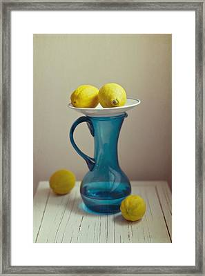 Blue Pitcher With Lemons On White Plate Framed Print by Copyright Anna Nemoy(Xaomena)