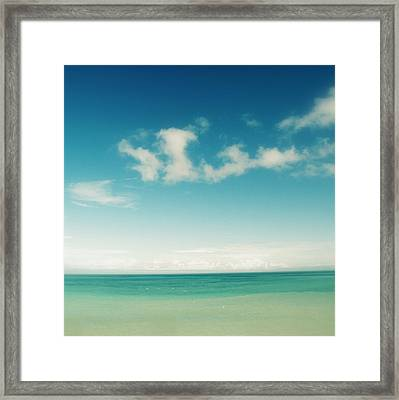 Blue Sky Over Ocean Framed Print by Jodie Griggs