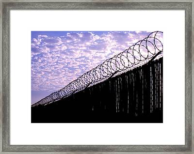 Blue Sunset And Barbed Wire Framed Print
