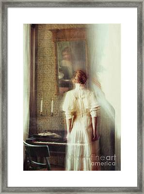 Blurry Image Of A Woman In Vintage Dress  Framed Print by Sandra Cunningham
