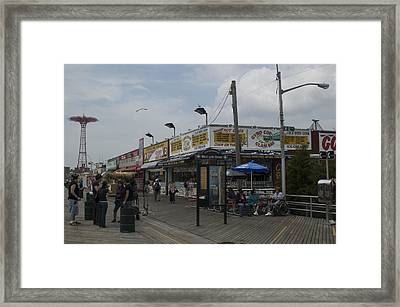 Boardwalk At Coney Island On A Cloudy Framed Print by Todd Gipstein