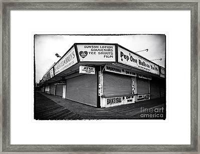 Boardwalk Shopping Framed Print by John Rizzuto
