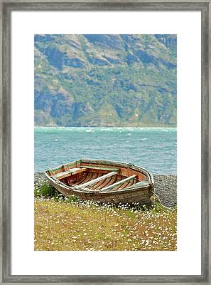 Boat And Wild Flowers By Sea Framed Print by M Moraes