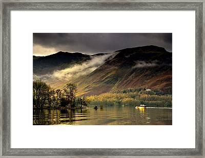 Boat On Lake Derwent, Cumbria, England Framed Print by John Short