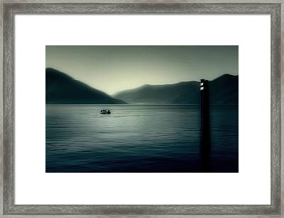 boat on the Lake Maggiore Framed Print by Joana Kruse