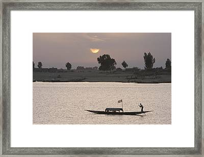 Boat On The Niger River In Mopti, Mali Framed Print by Peter Langer