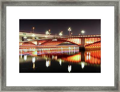 Boat Trails Under Bridge At Night Framed Print by By Counteragent