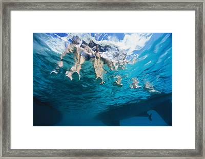 Boaters Dangle Their Feet Framed Print by Heather Perry