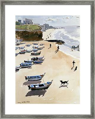 Boats On The Beach Framed Print by Lucy Willis
