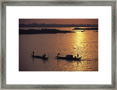 Boats Silhouetted On The Mekong River Framed Print by Steve Raymer