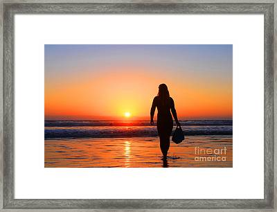 Bodysurfer At Dusk Framed Print by Sabino Cruz