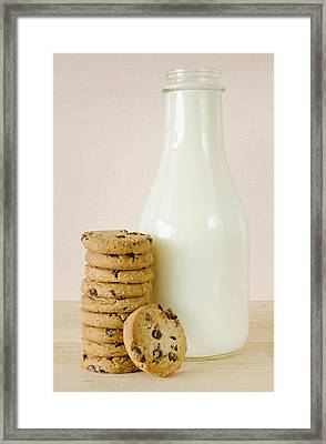 Bottle Of Milk And Chocolate Chip Cookies, Studio Shot Framed Print by Tetra Images