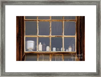 Bottles In The Window Framed Print by Vivian Christopher