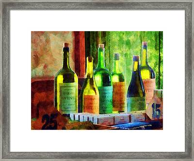 Bottles Of Wine Near Window Framed Print by Susan Savad