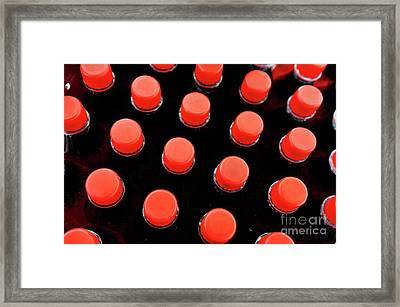 Bottles Red Caps Framed Print