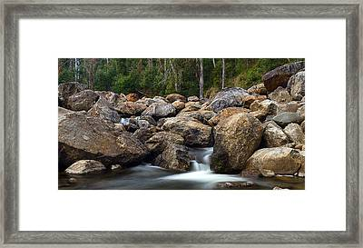 Boulders On The River Framed Print by Mark Lucey