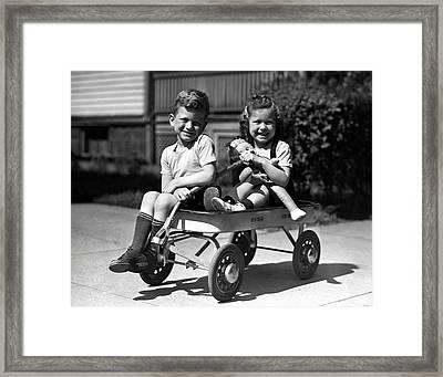 Boy & Girl On Wagon Framed Print by George Marks