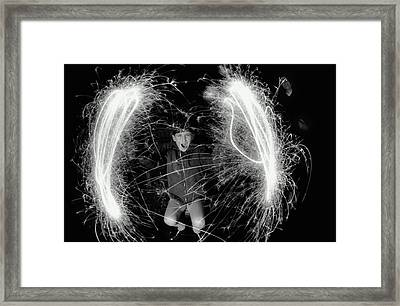 Boy (10-12) Making Circles With Sparklers, Outdoors, Portrait (b&w) Framed Print by Hulton Archive