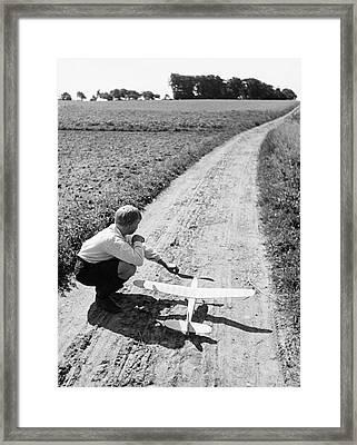Boy (10-12) With Model Plane On Dirt Path (b&w) Framed Print by Hulton Archive