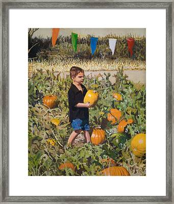 Boy At Pumpkin Festival Framed Print by Joanna Franke