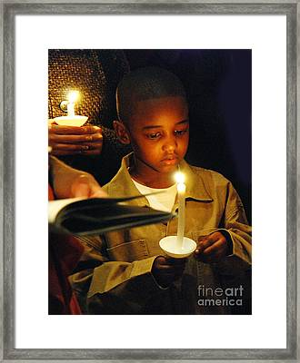 Boy By Candlelight Framed Print by Jim Wright