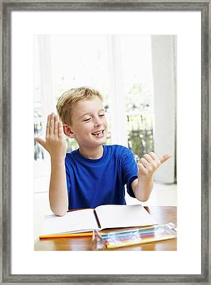 Boy Counting On His Fingers Framed Print by Ian Boddy
