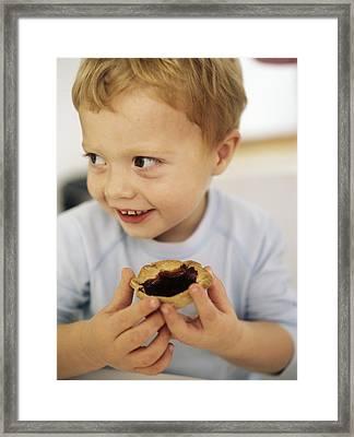 Boy Eating A Jam Tart Framed Print by Ian Boddy