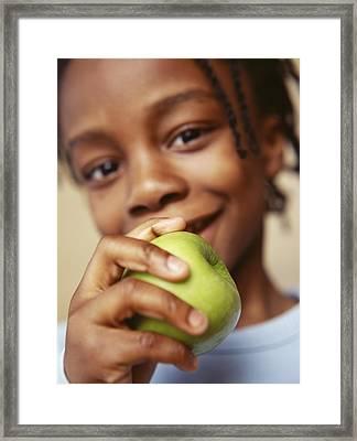 Boy Eating Apple Framed Print by Ian Boddy