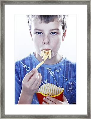 Boy Eating French Fries Framed Print by Kevin Curtis