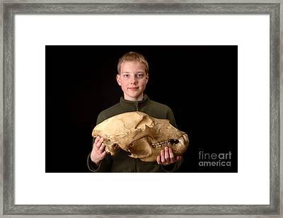 Boy Holding Kodiak Bear Skull Framed Print by Ted Kinsman
