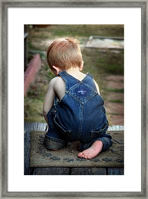 Framed Print featuring the photograph Boy In Overalls by Kelly Hazel